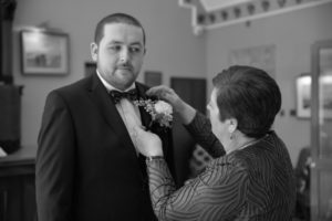 Groom and Mother getting ready for the wedding ceremony