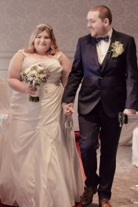 Bride and Groom Walking down isle photography