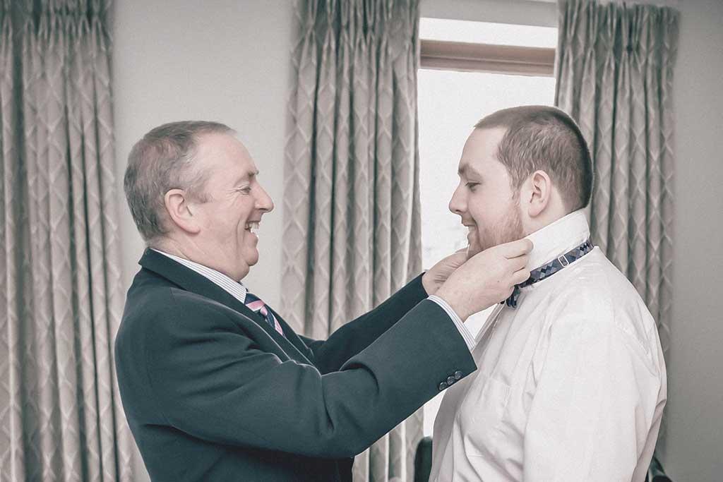 wedding photography groom getting ready